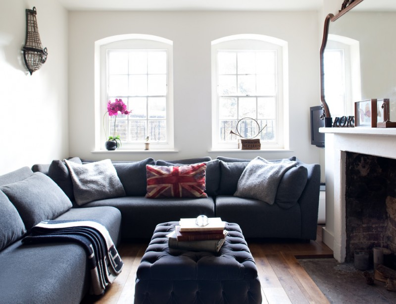 blue upholstered couch with blue tufted ottoman for coffee table