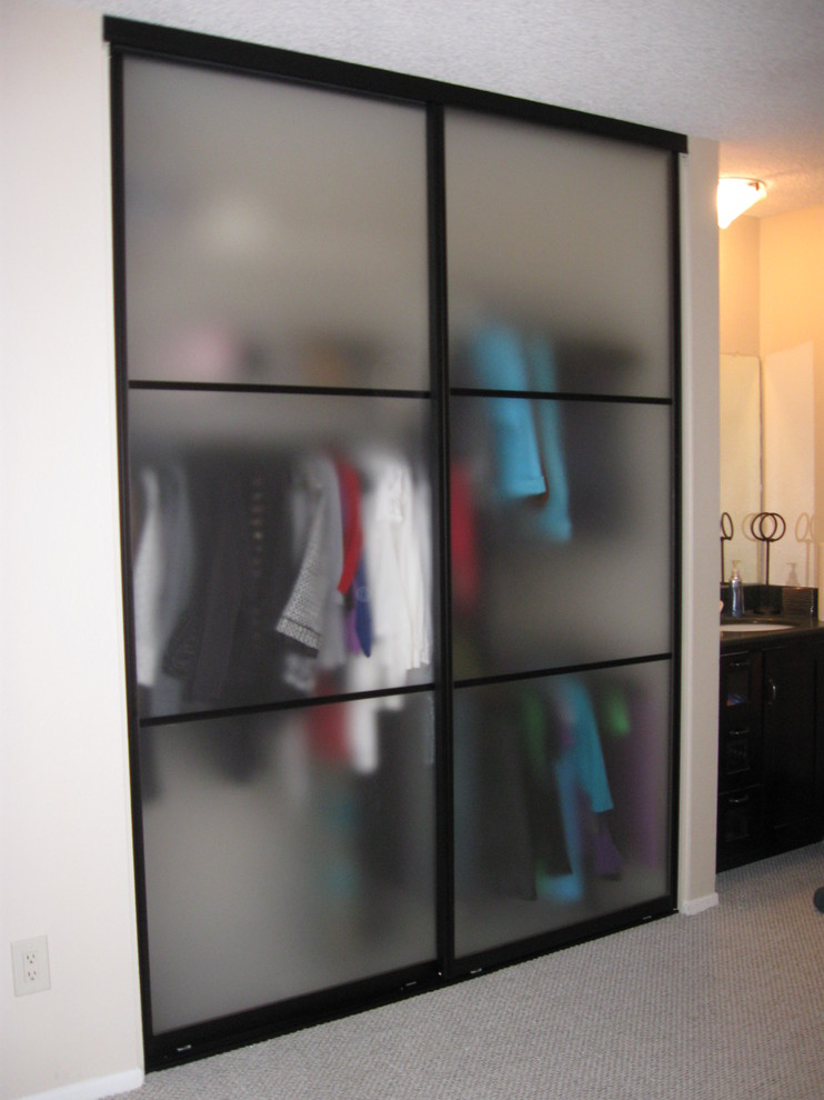 blurred sliding door closet design in small size accented by black frame