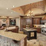 Brick Ceiling Brick Wall Marble Counter Top Dark Wooden Cabinet Tiled Granite Floor Hanging Lamps