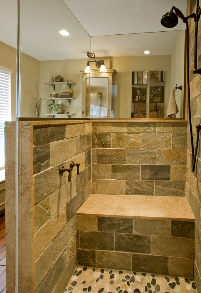 brown small master bathroom with brown stones in the shower area