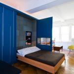 Brown Wooden Unfolding Bed With Blue Door Storage Cupboard, Built In Shelves On Headboard