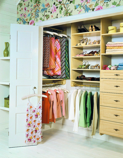 built in closet storage for women with flower painting headboard wall