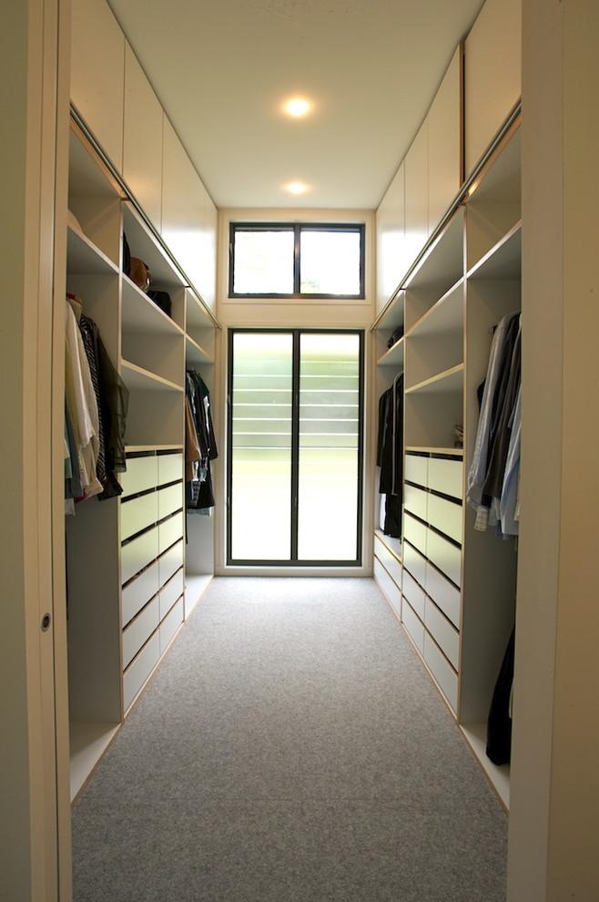 built in walk in closet idea in minimalist style grey rug idea minimalist glass window with black trims and additional top mini window