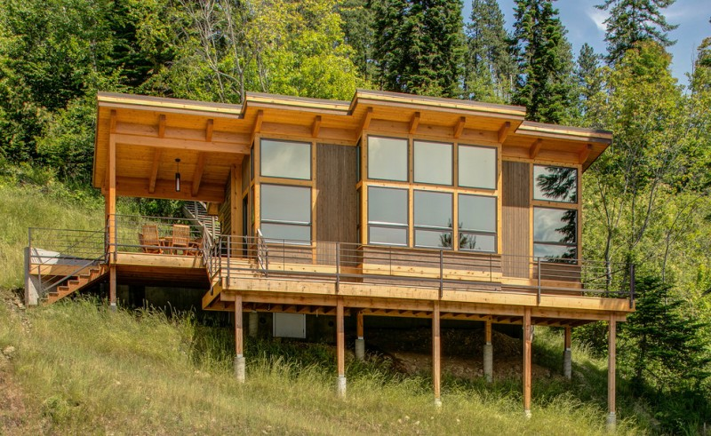 cabin exterior in wheel with mirror glass windows metal railing system cedar outdoor stairs