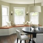 Cafe Curtains In White White Curve Bench With Comfortable Seater And Accent Pillows White Dining Chairs Rounded Black Dining Table Dark Toned Wooden Floors