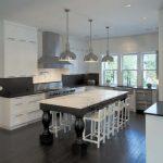 cashmere contertops kitchen dark floor windows glass storage item dining chairs metallic color hanging lamps door
