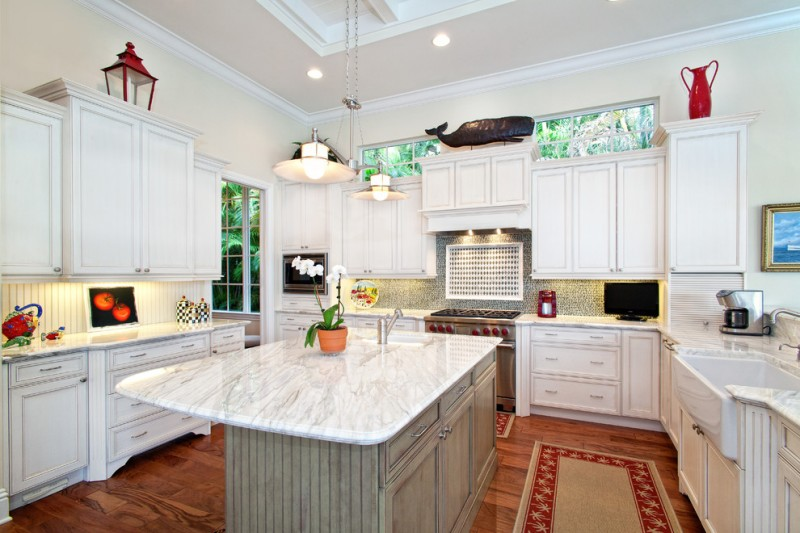 cashmere countertops kitchen carpet cabinets wood floor faucet sink stove window painting glass hanging lamps
