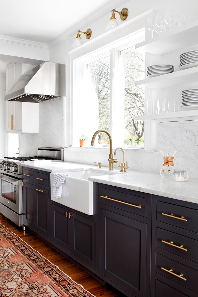 cashmere countertops kitchen carpet wood floor cabinet gold color stove faucet wall shelves plates wall lamp windows glass