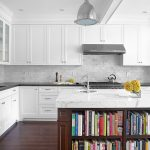 Cashmere Countertops Kitchen Wood Floor Bookshelves Faucet Sink Stove Hanging Lamp Cabinets Ceiling Light
