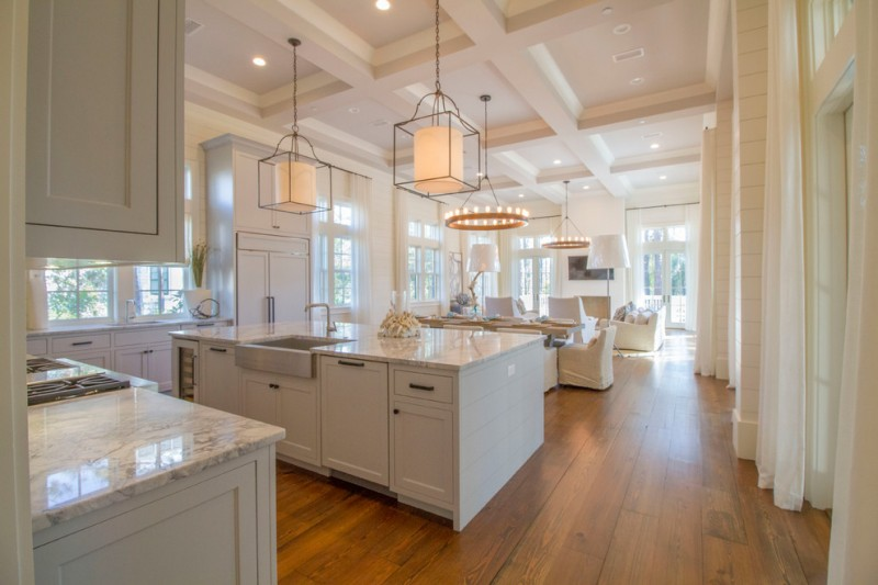 cashmere countertops kitchen wood floor cabinets faucet sink beach style sofa table windows lamps door curtains