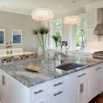Cashmere Countertops Kitchen Wood Floor Chairs Table Bench Paintings Faucet Sink Windows Stove Hanging Lamps