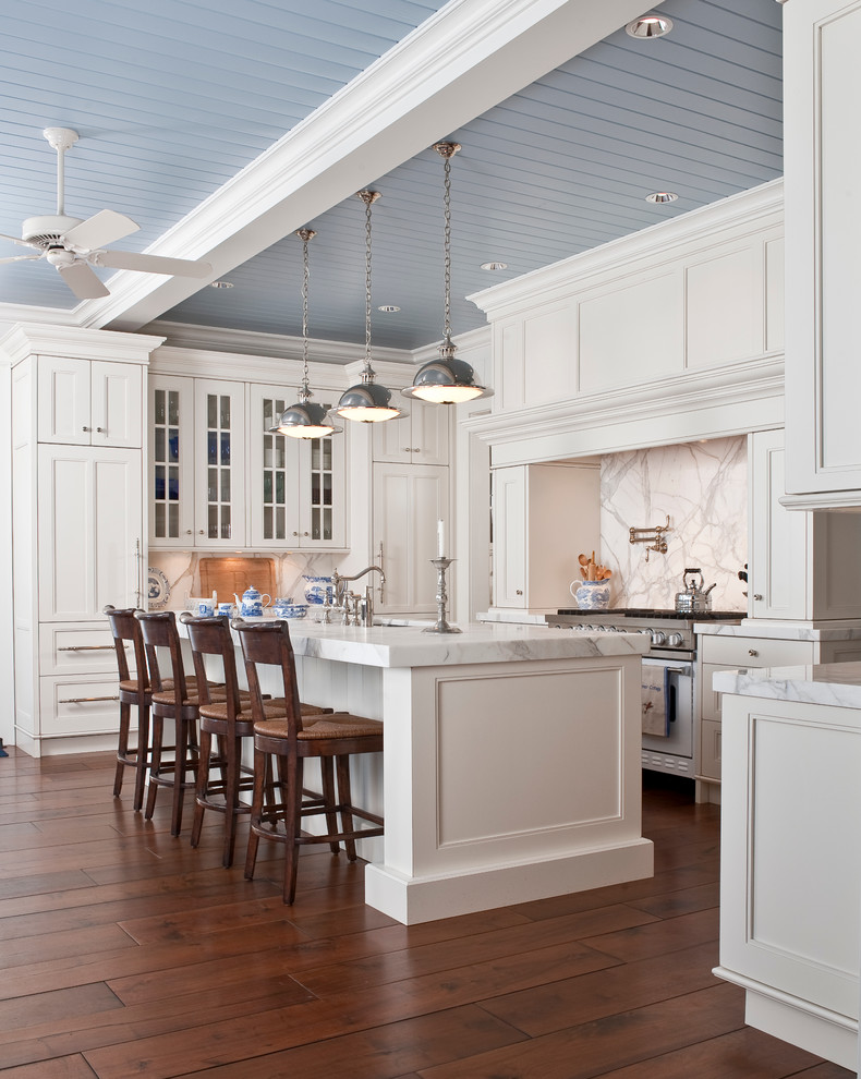 cashmere countertops kitchen wood floor dining chairs cabinets faucet sink hanging lamps ceiling fan