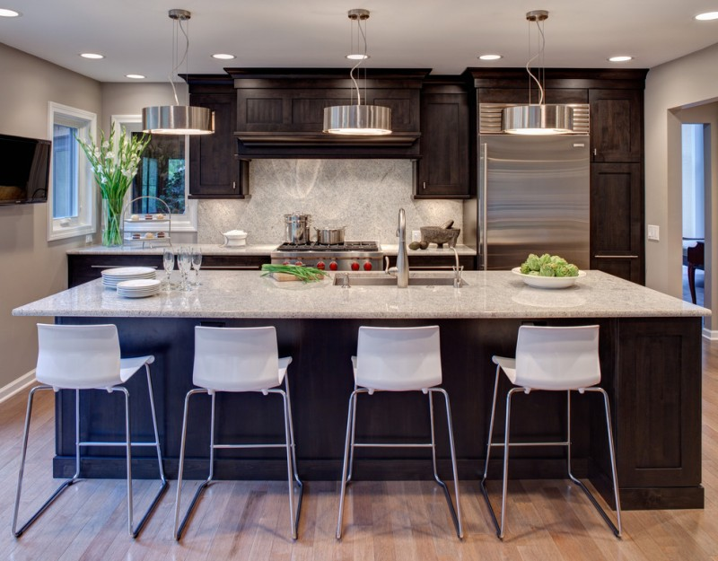 cashmere countertops kitchen wood floor dining chairs modern lamps stove faucet sink cabinets window wall tv plates glasses