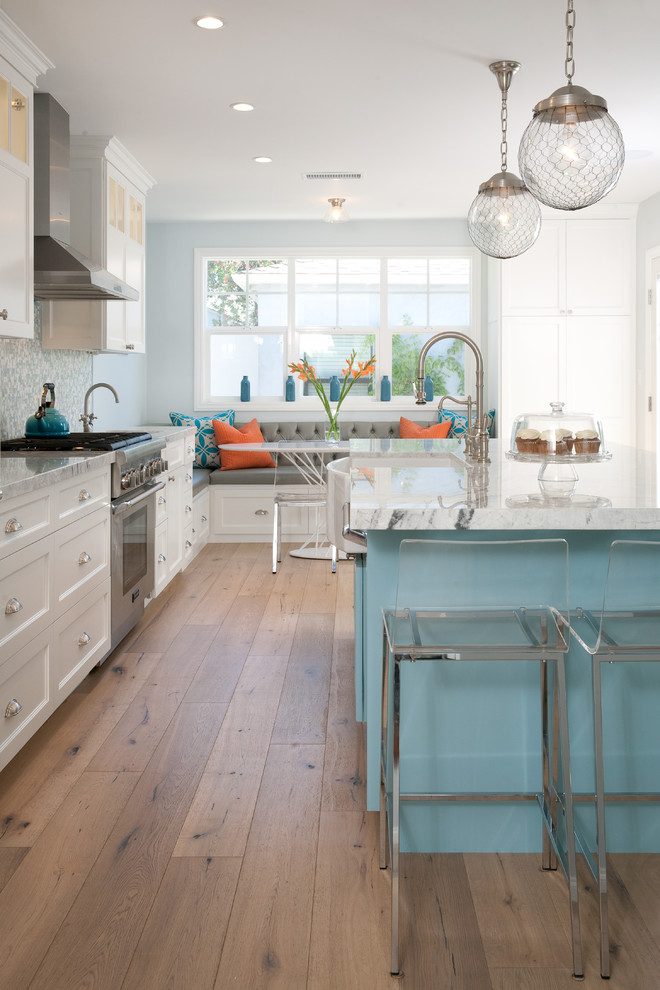cashmere countertops kitchen wood floor dining chairs with glass back faucet sink hanging lamps windows bench pillows