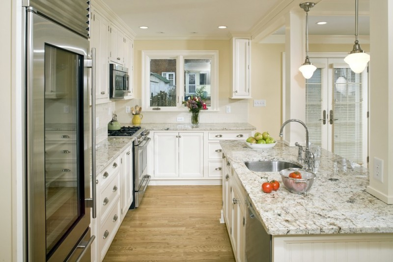 cashmere countertops kitchen wood floor window glass wall cabinets stove drawers faucet sink door lamps