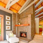Cedar Mantle Brick Fireplace Wooden Ceiling Sofa Pillow Photos Warm Grey Ceiling Lamp Wall Shelf