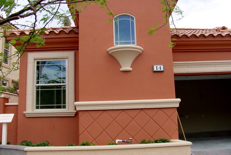 clay color exterior idea with two different exterior windows