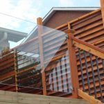 Clear Glass Rails With Wooden Posts