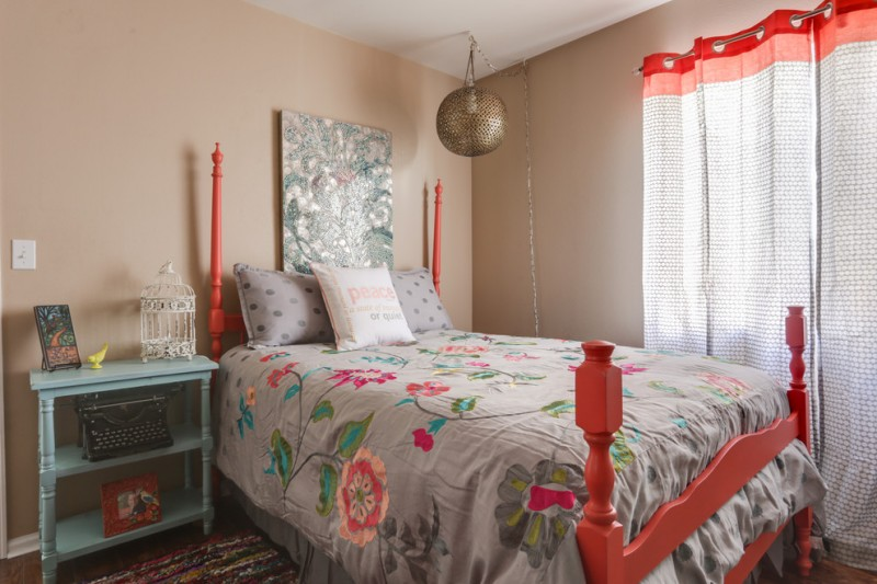 colorful bed sheet with beautiful flower motifs pillows with polka dots shams bed furniture with simple orange headboard light blue bedside tables grey curtains with orange top