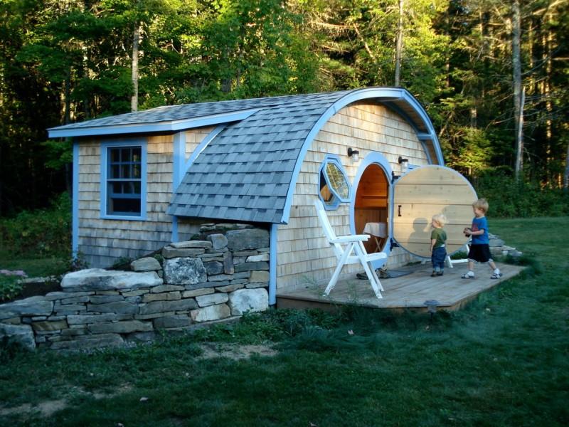 compact house design hobbit house hole door window chair roof wall wood floor eclectic exterior