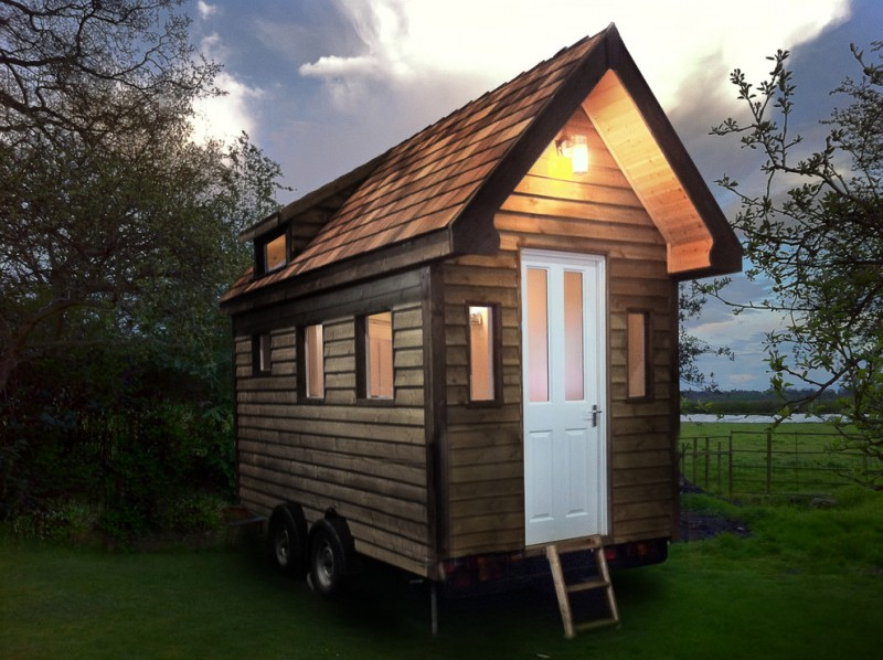 compact house designs door wall lamp windows wood wall wheels roof traditional look shed exterior