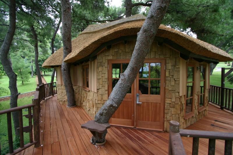 compact house designs tree house wood door floor glass windows unique design railings rustic style