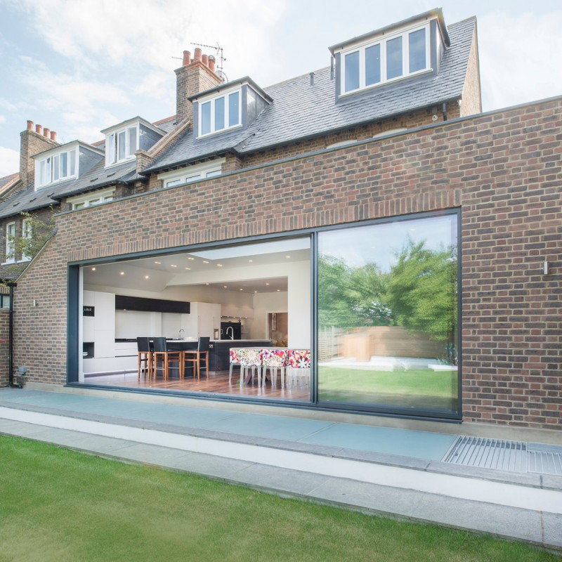 contemporary exterior design with modern showroom windows on top full glass window at ground floor red black bricks walls