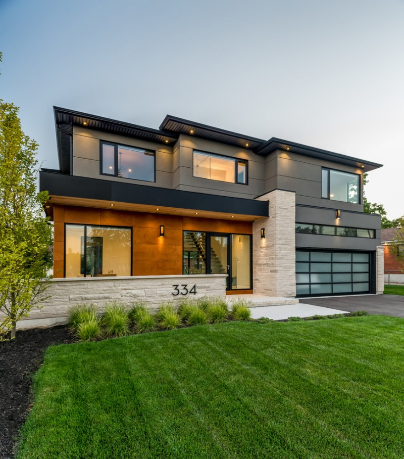 contemporary exterior house idea with flat roofs and dominant grey walls