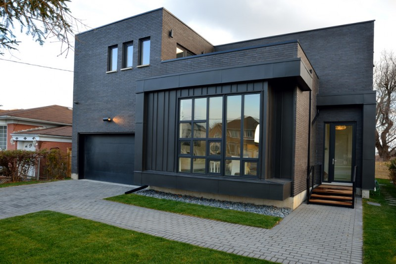contemporary home design with large mirror glass windows glass entrance door and mid size mirror glass windows at top