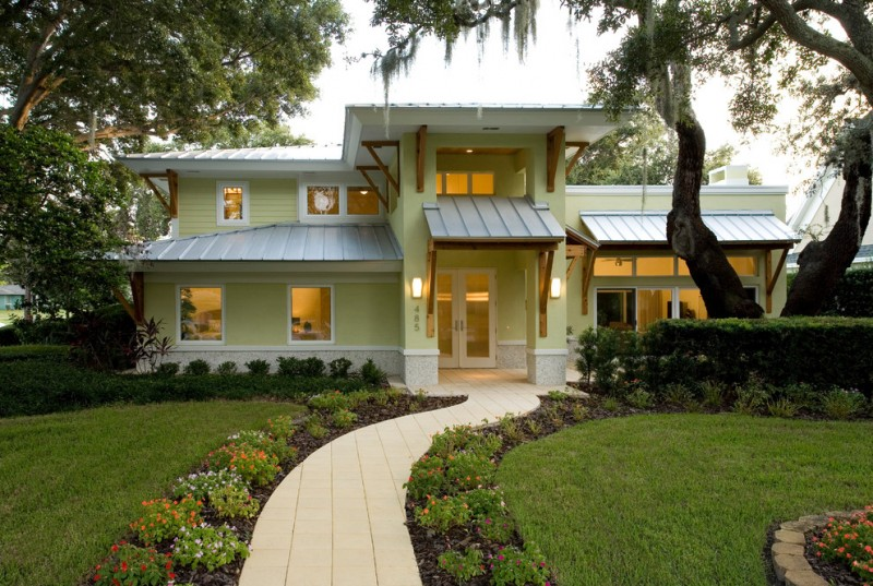 contemporary house exterior idea with coastal accent additions simple & minimalist exterior windows two panels entrance door modern tiles walkway idea