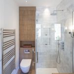 Contemporary Small Bathroom With Grey White Ceramic Tiles Wall Onthe Shower Area, Wood Color Ceramic Tiles On White Toilet Area, Towels Rails