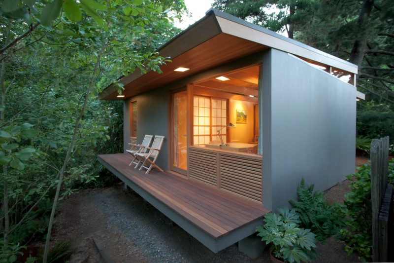 contemporary small home with grayish blue outside wall