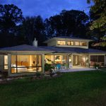 Contemporary Two Stories Small Home With Wide And Large Glass Window In All Back Side, And Yard