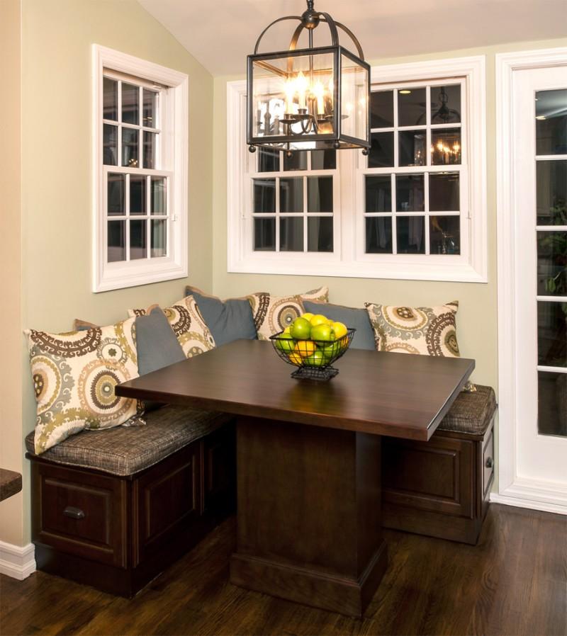 corner bench kitchen set with dark bench, dark cushion, dark wood table, nude pillow, lantern