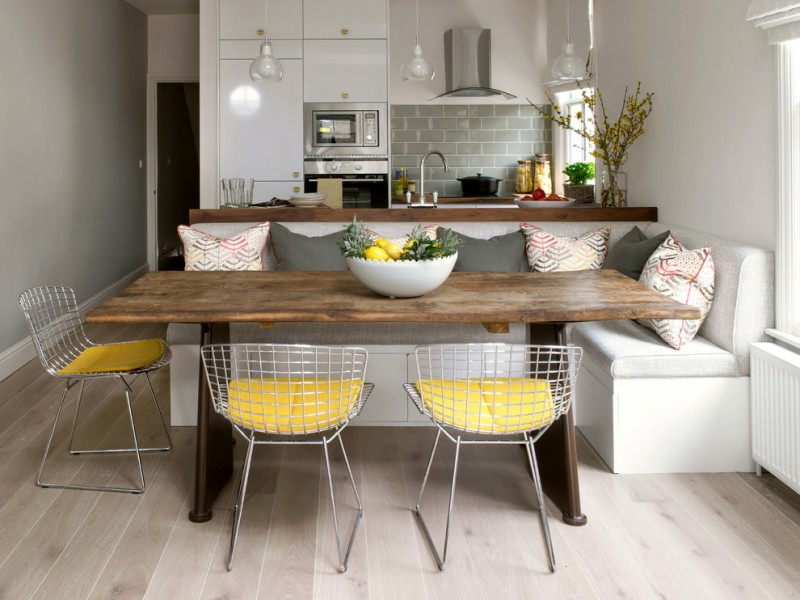 corner bench with white wooden benh, white cuhion, brown wood table, wire look chair with yellow cushion