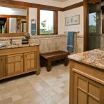 Craftsman Bathroom With Brown Tiles, Brown Wooden Cabinet With Brown Marmer Counter Top, Dark Brown Long Low Chair, Brown Tile Wainscoting, Brown Framed Window And Door