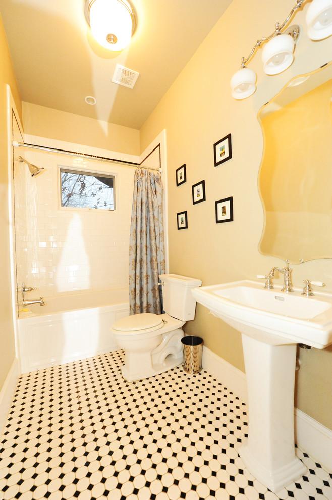 craftsman bathroom with soft orange wall, white wastafel, mirror, white toilet, soft orange black tiles, white tub, white tiles for shower and tub area, yellow lighting