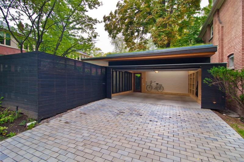 dark garage red brick wall brick pave wooden flat panel shelves