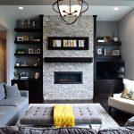 Dark Hardwood Floor Grey Sofa Modern Pendant Light Brick Fire Place Wall Open Floating Shelves