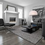 Dark Hardwood Floor Grey Wall Black Couches Customized Living Room Table Urban Wall Picture Contemporary Hanging Lamp