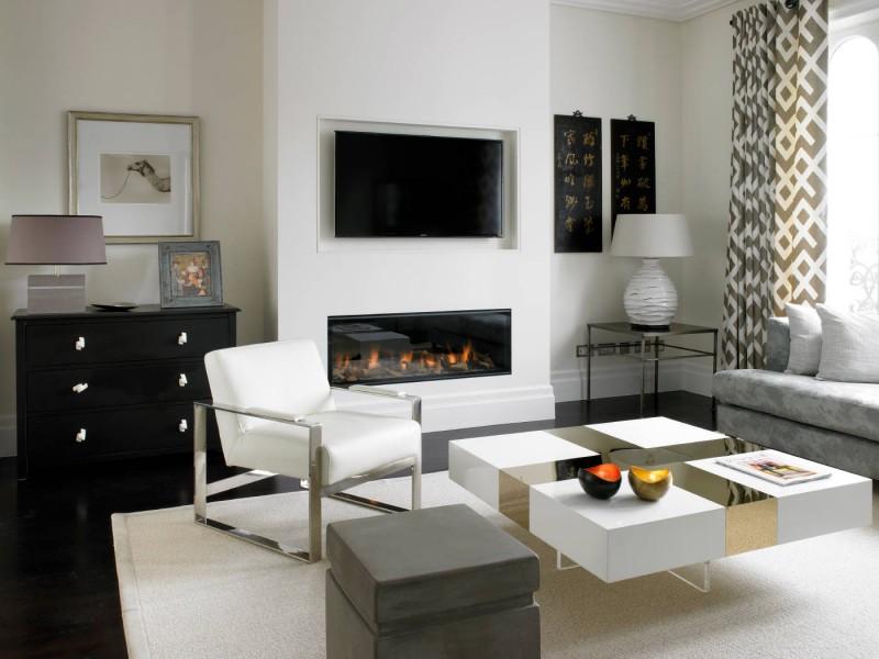 dark hardwood floor square coffee table white fire place wall grey sofa