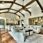 Dark Harwood Floor Grey Sofa Decorative Archway Area Rug Wine Storage Kitchen Bar Wood Ceiling Beams