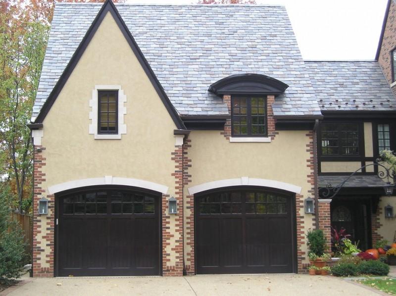 dark two car garage grey tiled roof beige siding brick siding