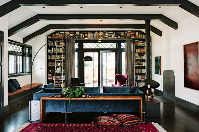 dark wood book shelves surround the arch wall