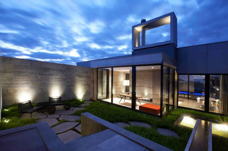 design footpath made by stone chairs seating modern design table modern lighting door grass stones
