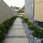 design footpath made by stone light colored stones footpath wall house plants exterior modern design