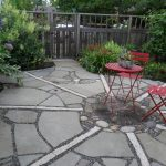 Design Footpath Made By Stone Red Chairs Stones Flowers Trees Patio Fence Red Table Outdoor Area Stones