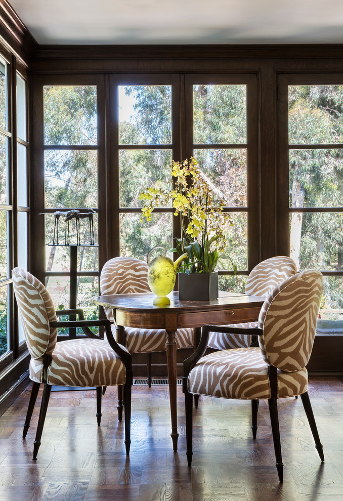 dining room with brown zebra pattern chairs, round wooden table