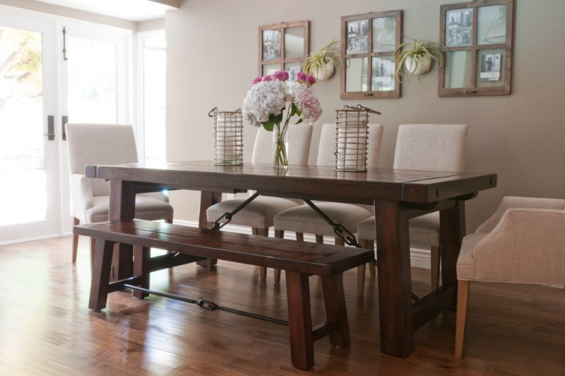 dining set with dark wood table, dark wood bench, white leathered chairs