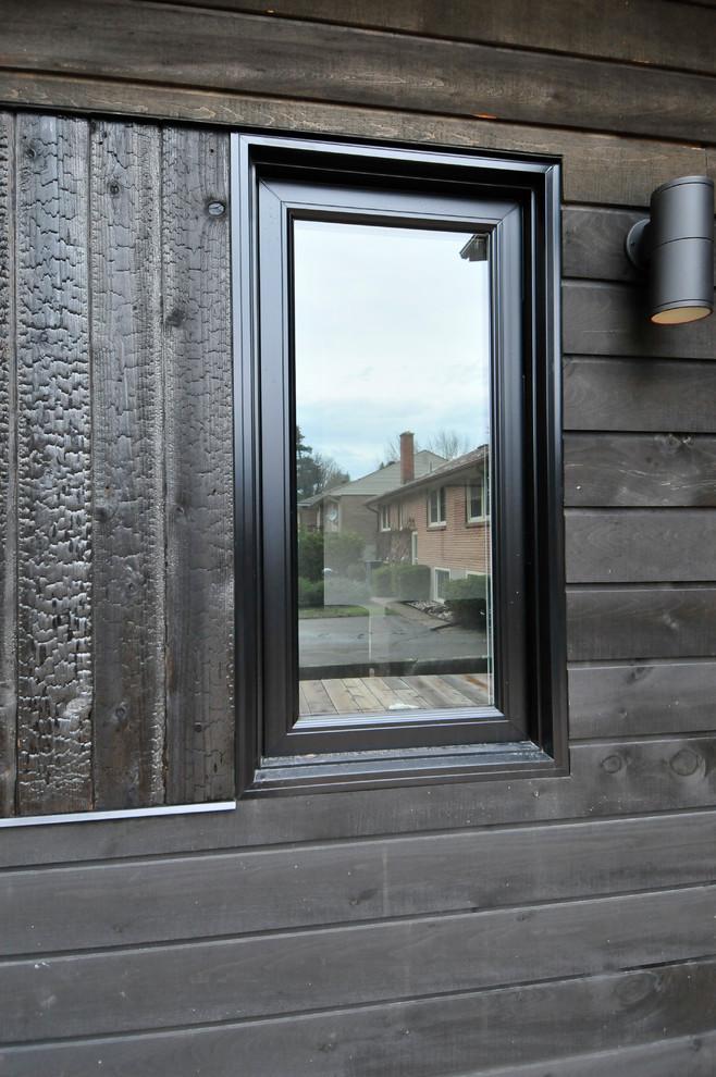 dove black siding exterior with black vinyl and burnt cedar exterior windows